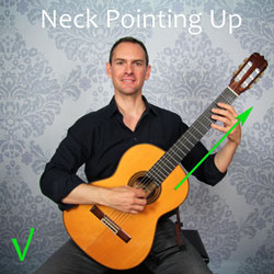 Holding A Guitar : how to hold a guitar without destroying your body ~ Vivirlamusica.com Haus und Dekorationen